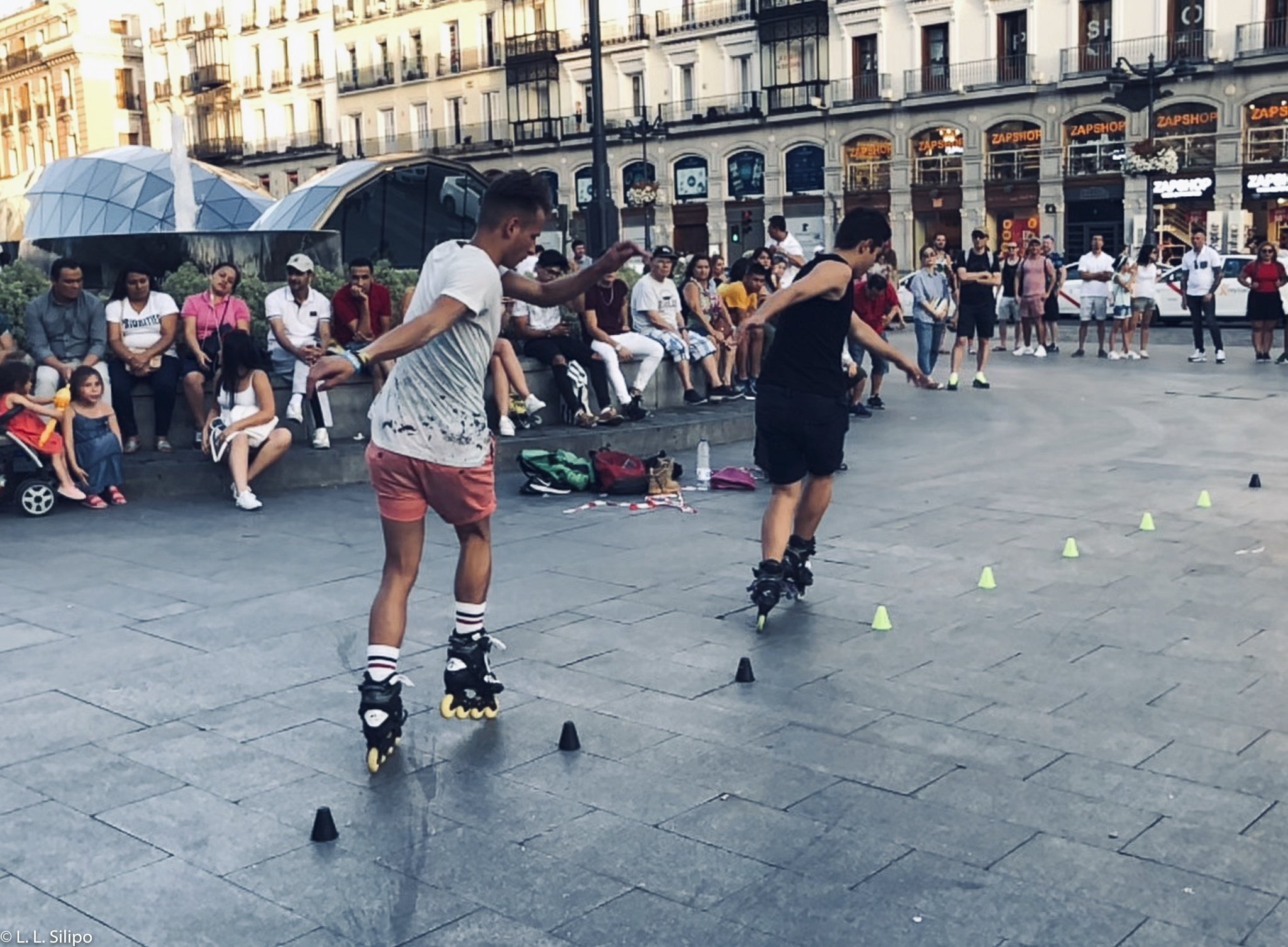 Madrid, Spain, Stunt, city, europe, iberia, motion, people, puerta del sol, roller, rollerbladers, rollerblading, spanish, sport, square, street